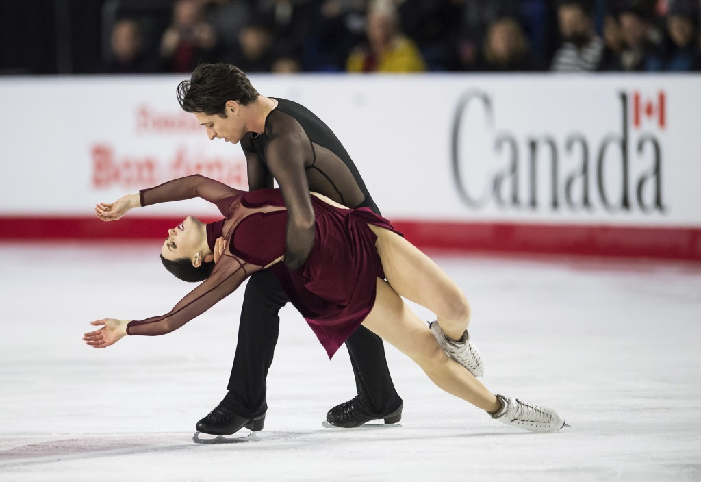 Tessa Virtue, front, and Scott Moir perform their free dance routine in the ice dancing competition at the Canadian Figure Skating Championships in Va