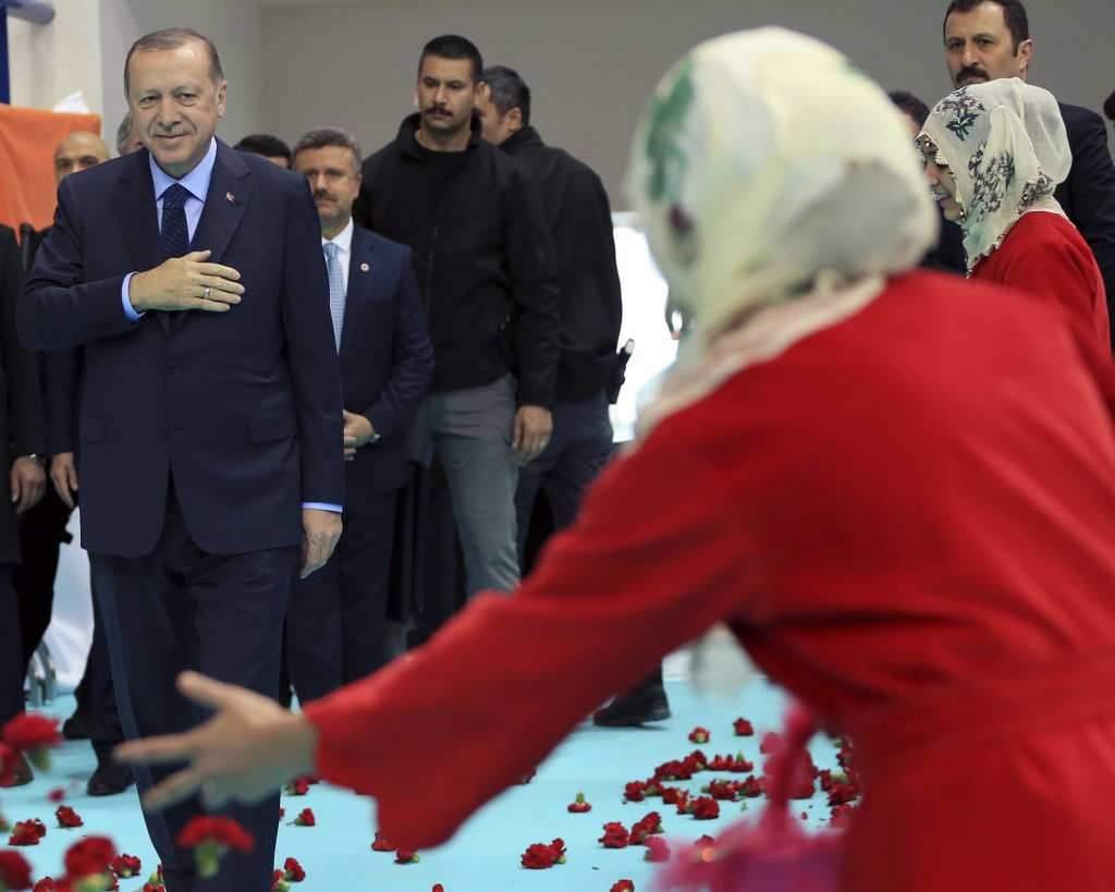 Turkey's President Recep Tayyip Erdogan, left, arrives at a rally of his ruling Justice and Development Party (AKP), at a rally in Elazig, eastern Tur
