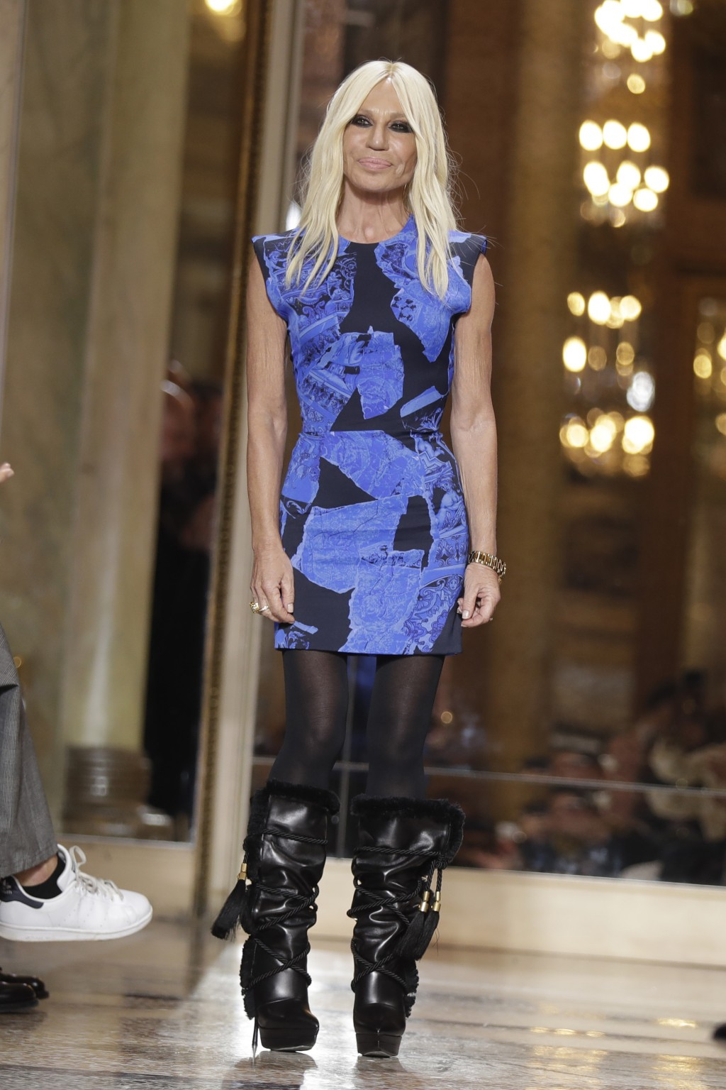 Donatella Versace acknowledges the applause after presenting her men's Fall-Winter 2018-19 collection, that was presented in Milan, Italy, Saturday, J