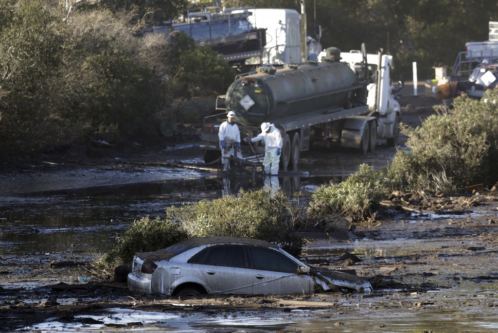 Crews pump mud on Highway 101 after a mudslide Saturday, Jan. 13, 2018, in Montecito, Calif.  Most of the people of Montecito, a town usually known fo