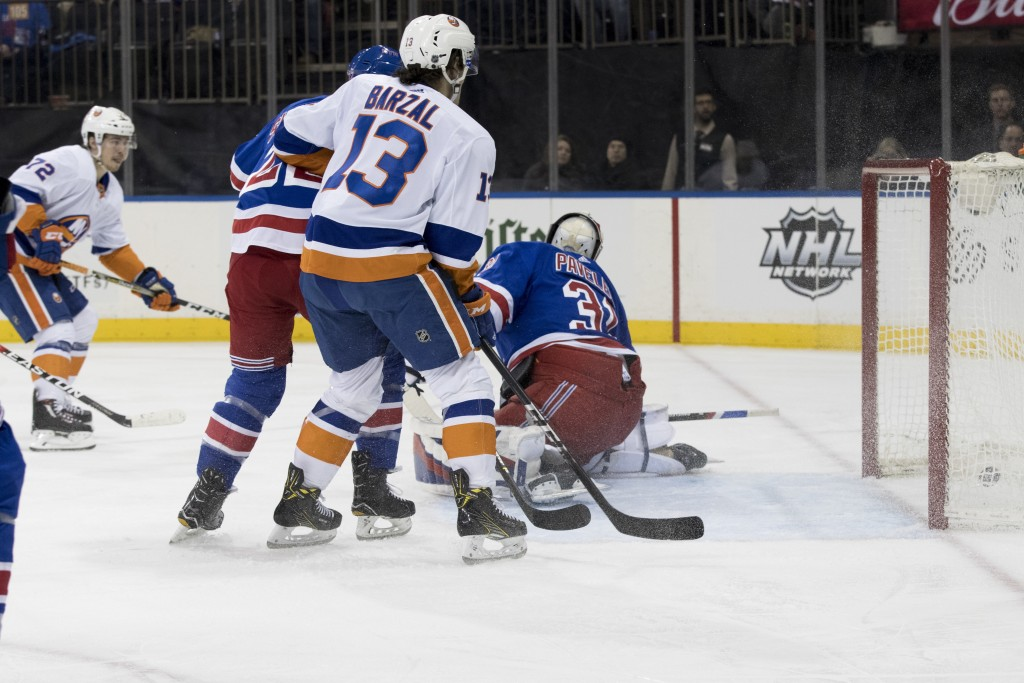 New York Islanders center Anthony Beauvillier (72) scores a goal past New York Rangers goaltender Ondrej Pavelec (31) during the first period of an NH