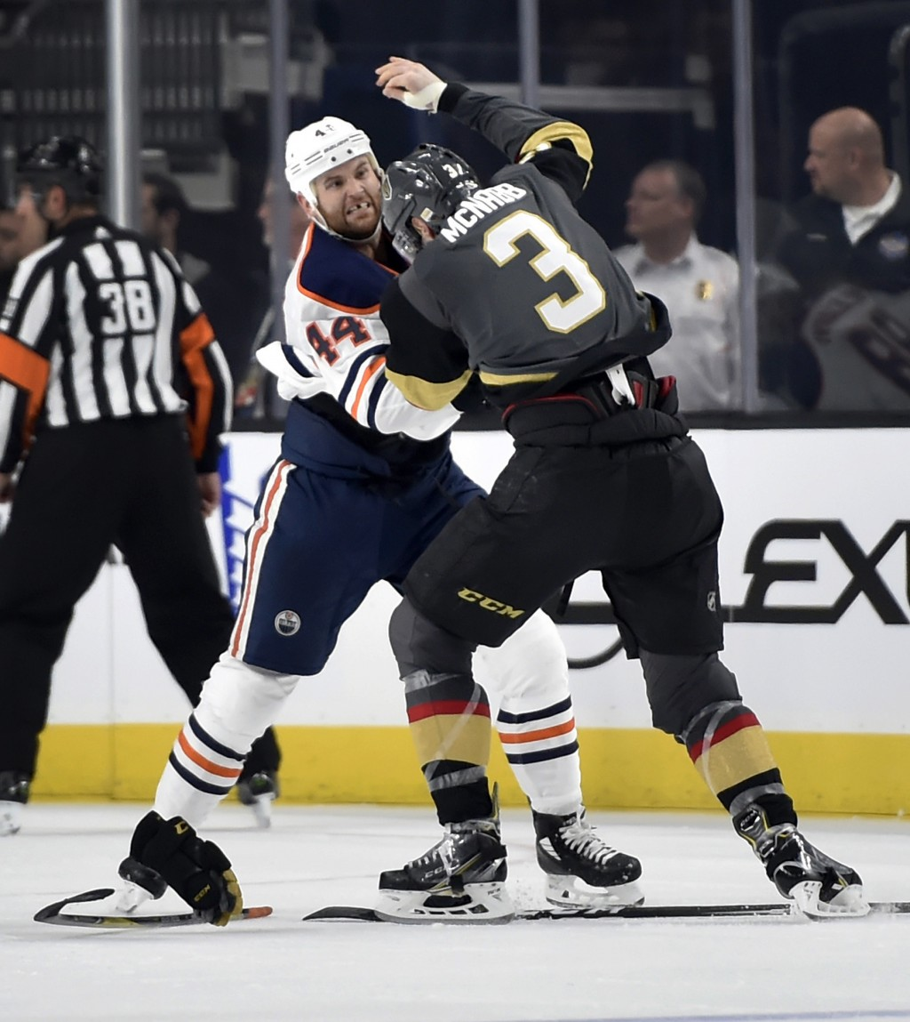 Edmonton Oilers right wing Zack Kassian (44) and Vegas Golden Knights defenseman Brayden McNabb get into a scuffle during the second period of an NHL
