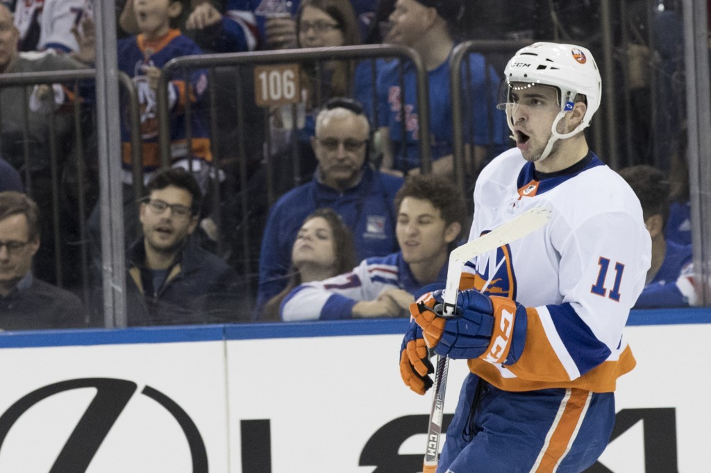 New York Islanders left wing Shane Prince reacts after scoring a goal during the first period of an NHL hockey game New York Rangers, Saturday, Jan. 1