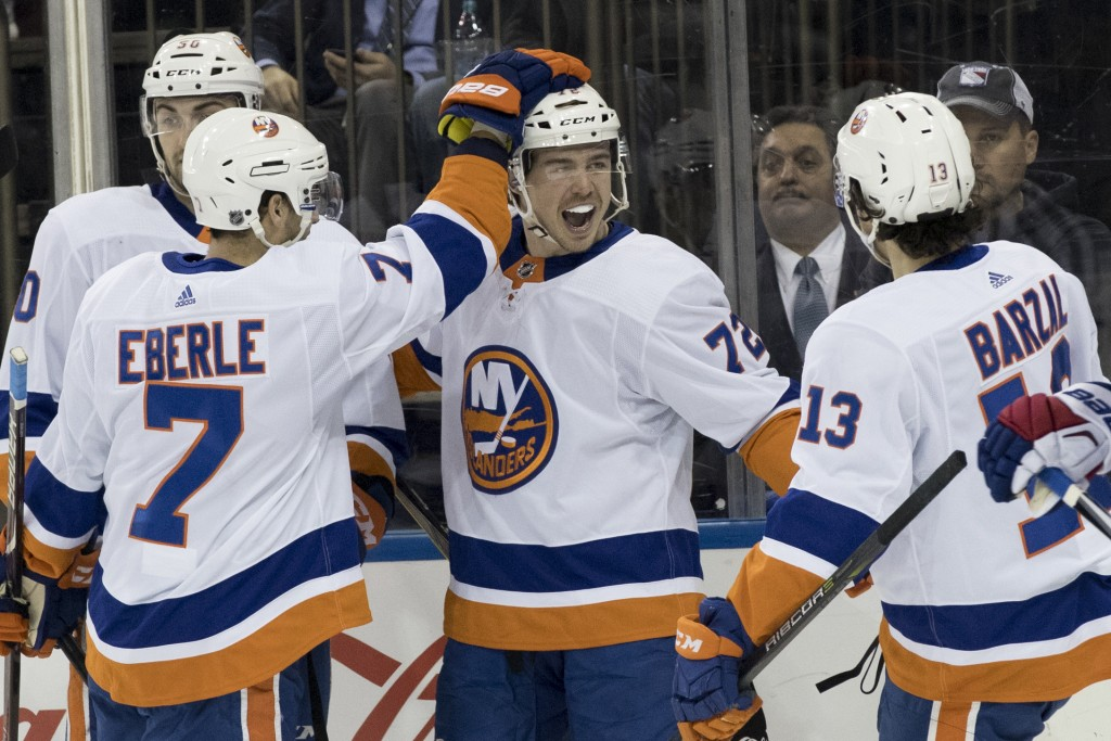 New York Islanders center Anthony Beauvillier (72) celebrates with his team mates after scoring a goal during the first period of an NHL hockey game a