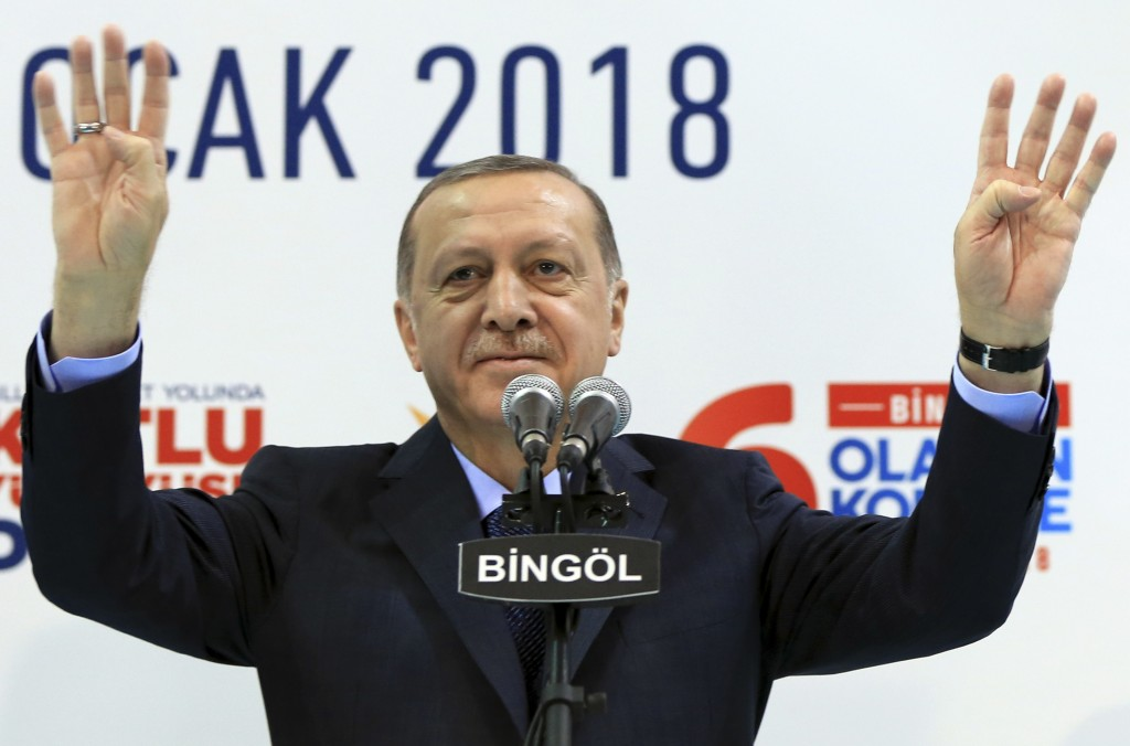 Turkey's President Recep Tayyip Erdogan gestures to supporters of his ruling Justice and Development Party (AKP), at a rally in Bingol, eastern Turkey