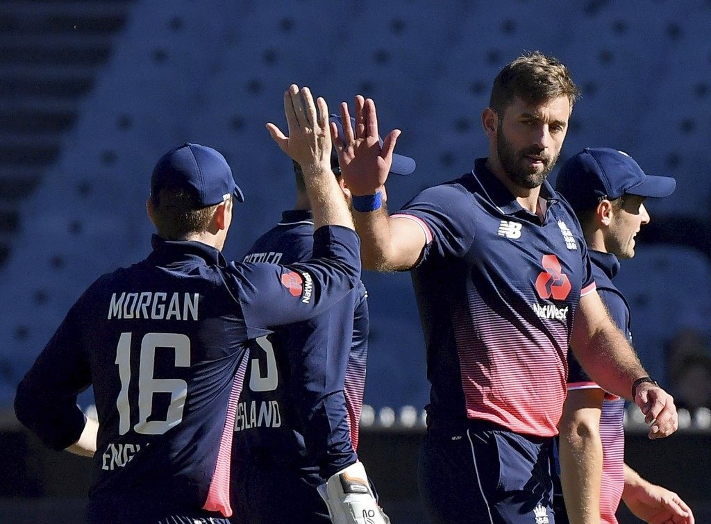 England's Liam Plunkett, right is congratulated by captain England's Eoin Morgan after capturing the wicket of Australia's Tim Paine during their ODI