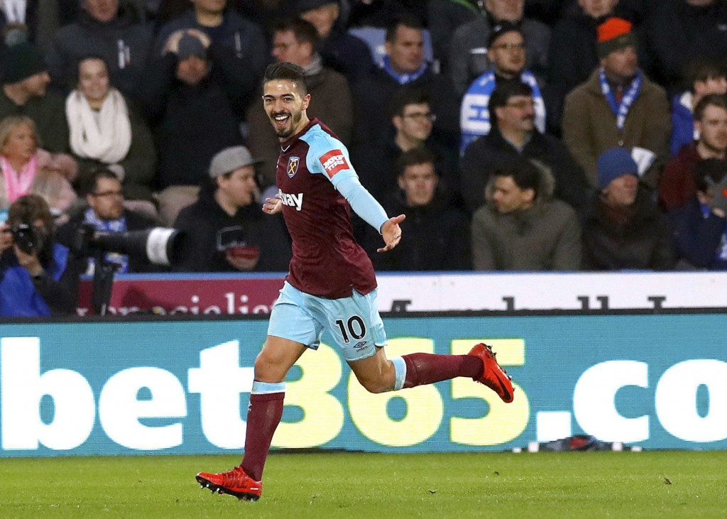 West Ham United's Manuel Lanzini celebrates scoring his side's fourth goal of the game against Huddersfield Town during the English Premier League soc