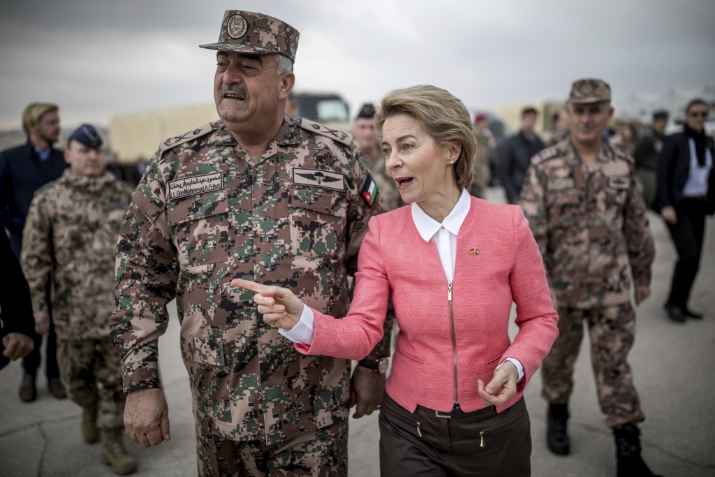 German Defense Minister Ursula von der Leyen, right, speaks with Jordanian Jordanian Chairman of the Joints Chief of Staff Mahmoud Freihat  at her vis