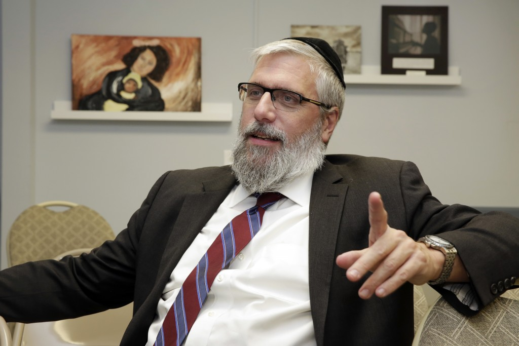 In this Wednesday, Jan. 10, 2018 photo, Director & CEO Rabbi Sholom Friedmann of the Amud Aish Memorial Museum, is interviewed at the facility in Broo
