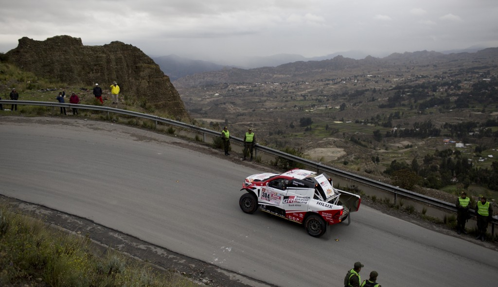 Toyota driver Giniel De Villiers, of South Africa, and co-driver Dirk Von Zitzewitz, of Germany, depart from La Paz, Bolivia, for the Dakar Rally stag
