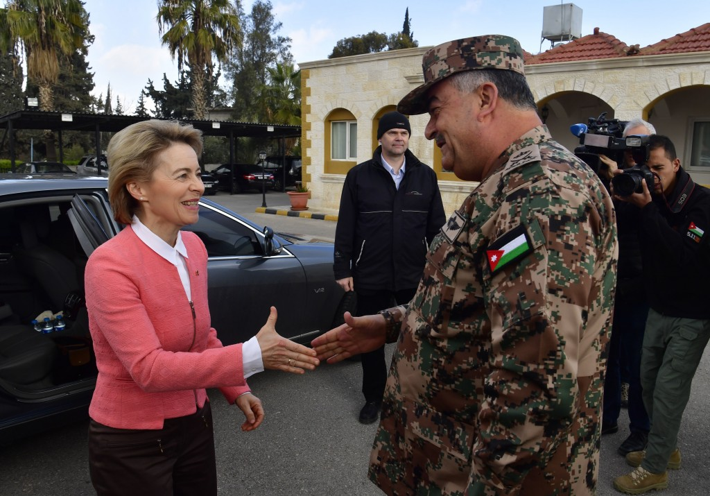 German Defence Minister Ursula von der Leyen, left, shakes hands with Jordanian Chairman of the Joints Chief of Staff Mahmoud Freihat prior to a cerem