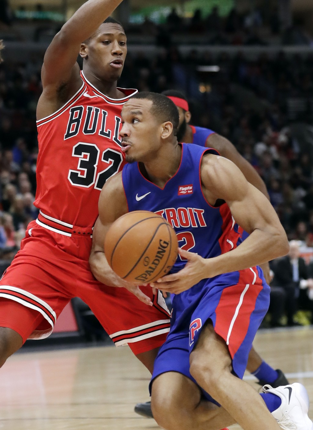 Detroit Pistons guard Avery Bradley, right, drives to the basket against Chicago Bulls guard Kris Dunn during the first half of an NBA basketball game