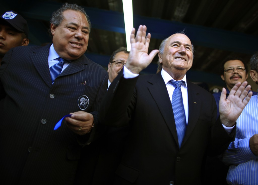 FILE - This April 14, 2011 file photo shows Nicaragua Soccer Federation President Julio Rocha, left, and FIFA President Joseph S. Blatter, at the end