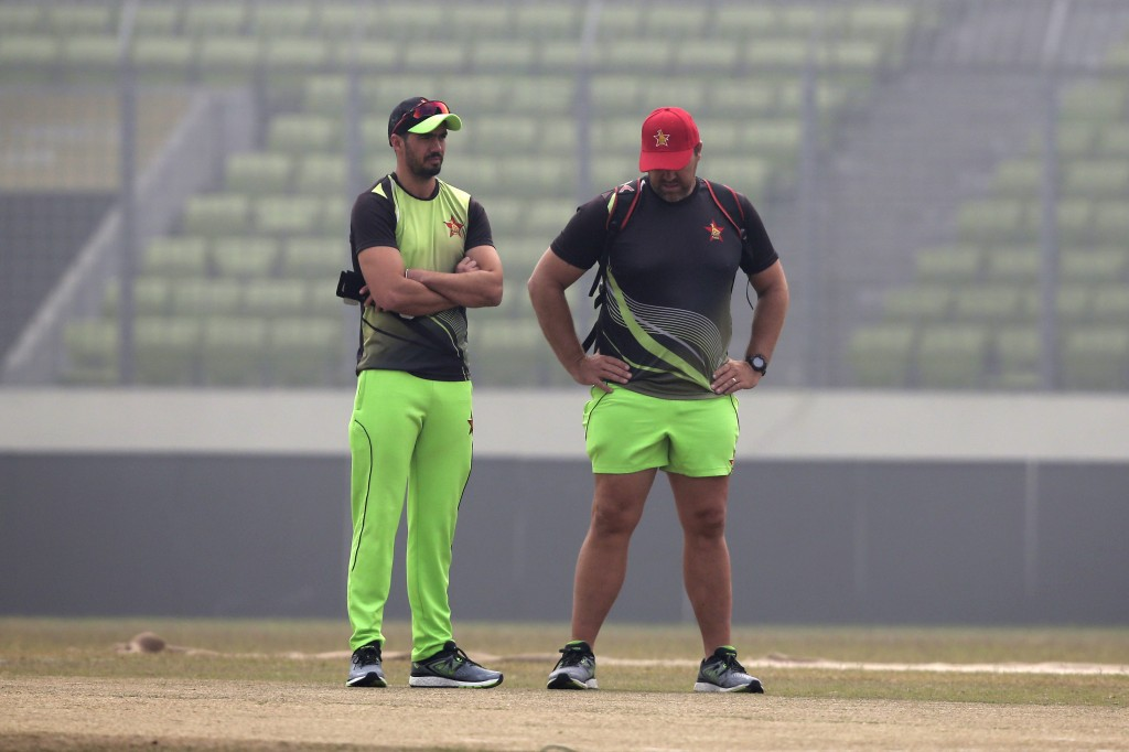 Zimbabwe's cricket team captain Graeme Cremer, left, and head coach Heath Streak inspect the pitch during a training session ahead of the Tri-Nation o