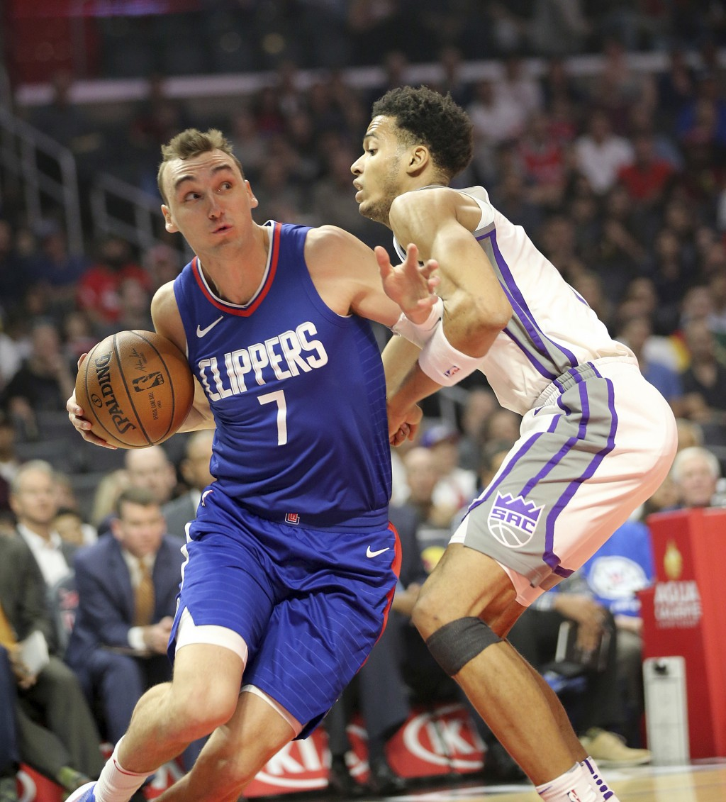 Los Angeles Clippers forward Sam Dekker, left, drives as Sacramento Kings forward Skai Labissiere, right, defends in the first period of an NBA basket