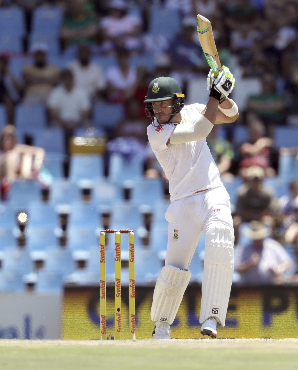 South Africa's captain Faf du Plessis' watches his shot during the second day of the second cricket test match between South Africa and India at Centu