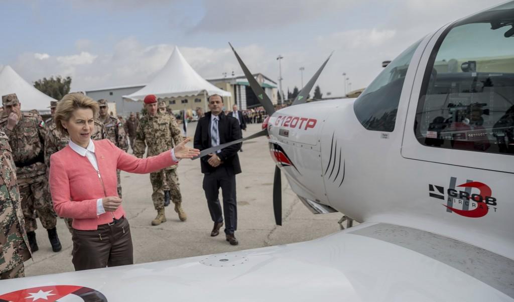 German Defense Minister  Ursula von der Leyen, stands next to an  training plane at Marka airport,  Amman , Jordan Jan. 14, 2018. prior to a handing o