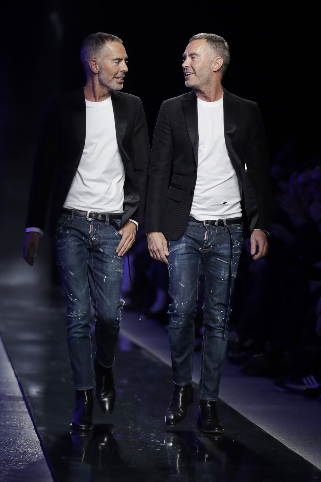 Designers Dan Caten and Dean Caten accept applause at the end of the Dsquared2 men's Fall-Winter 2018-19 collection, that was presented in Milan, Ital