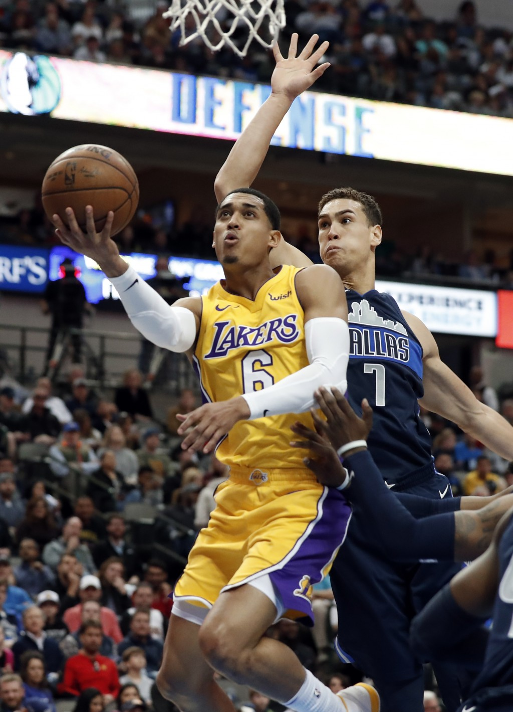 Los Angeles Lakers guard Jordan Clarkson (6) goes up for a shot after getting past Dallas Mavericks forward Dwight Powell (7) in the first half of an