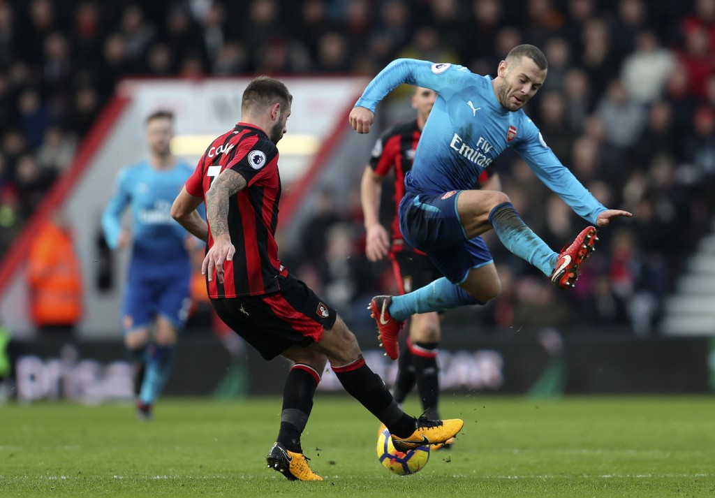 Arsenal's Jack Wilshere, right, is tackled by Bournemouth's Steve Cook during the English Premier League soccer match against Bournemouth at the Vital