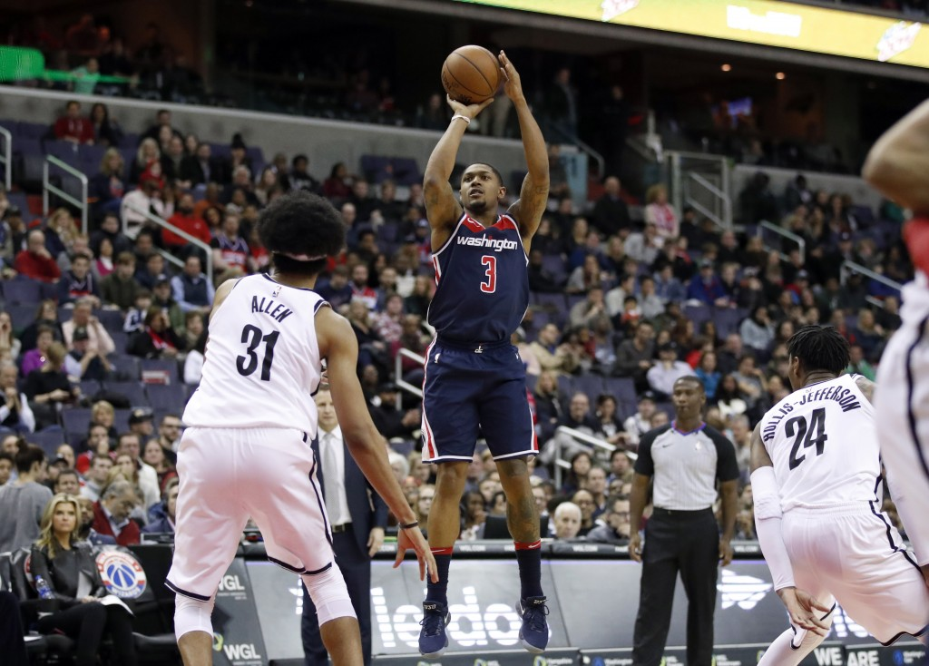 Washington Wizards guard Bradley Beal (3) shoots between Brooklyn Nets center Jarrett Allen (31) and forward Rondae Hollis-Jefferson (24) during the o