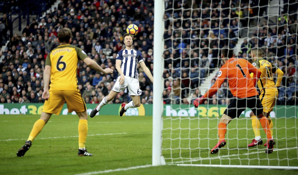 West Bromwich Albion's Jonny Evans scores his side's first goal of the game against Brighton & Hove Albion during the English Premier League soccer ma