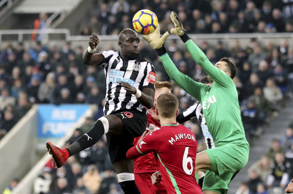 Newcastle United's Mohamed Diame, left, heads towards goal during the English Premier League soccer match against Swansea City at St James' Park, Newc