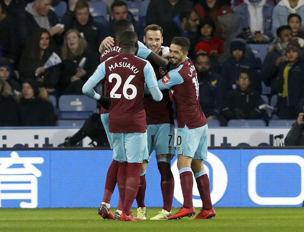 West Ham United's Marko Arnautovic, facing, celebrates scoring his side's second goal of the game against Huddersfield Town with teammates during the