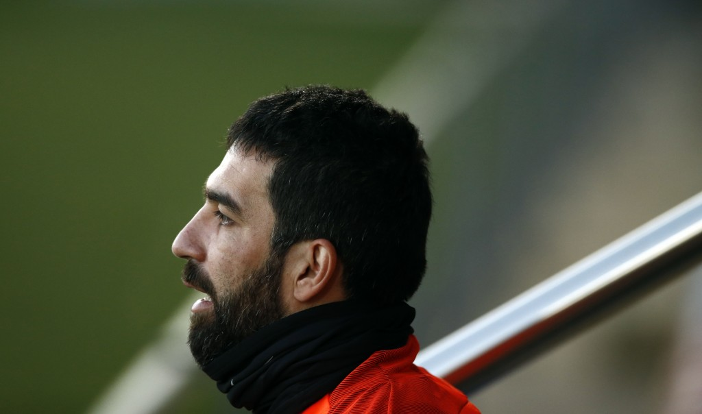 FILE - In this Monday, Dec. 4, 2017 file photo, FC Barcelona's Arda Turan takes part in a training session at the Sports Center FC Barcelona Joan Gamp
