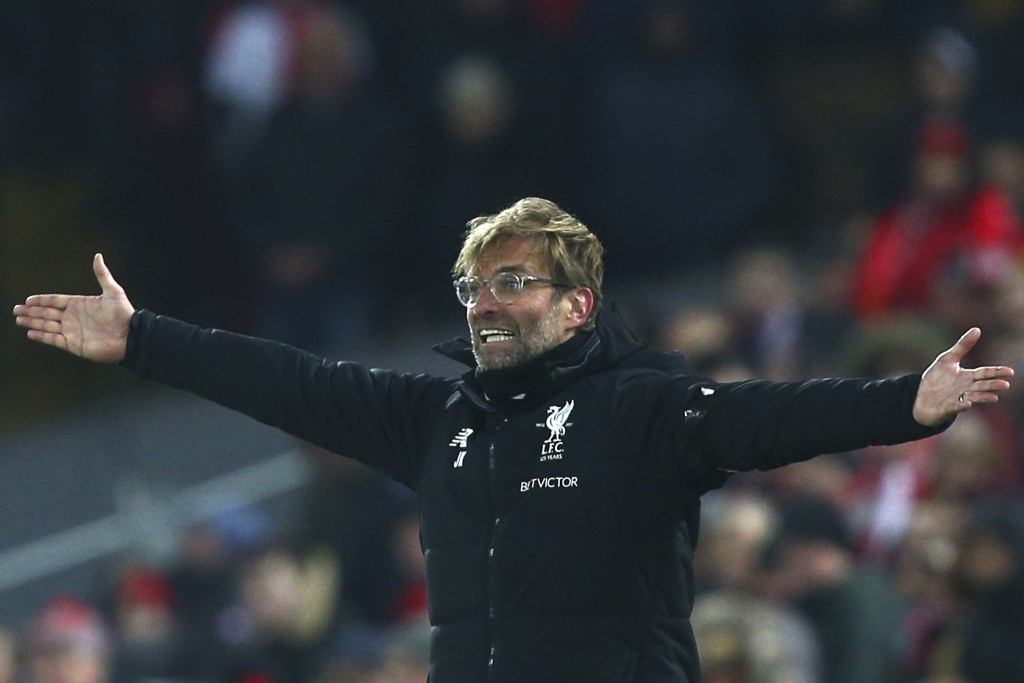Liverpool's manager Juergen Klopp gestures during the English Premier League soccer match between Liverpool and Manchester City at Anfield Stadium, in