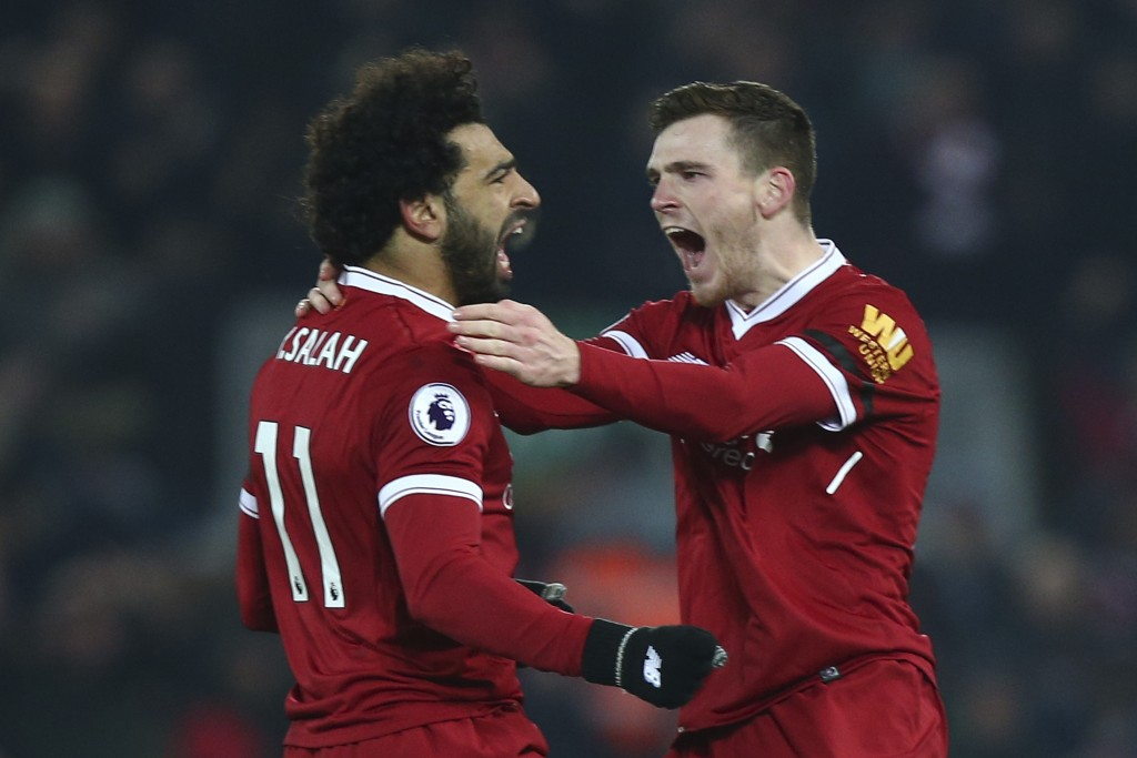 Liverpool's Andrew Robertson, right, celebrates with Mohamed Salah after Salah scored his side's fourth goal during the English Premier League soccer