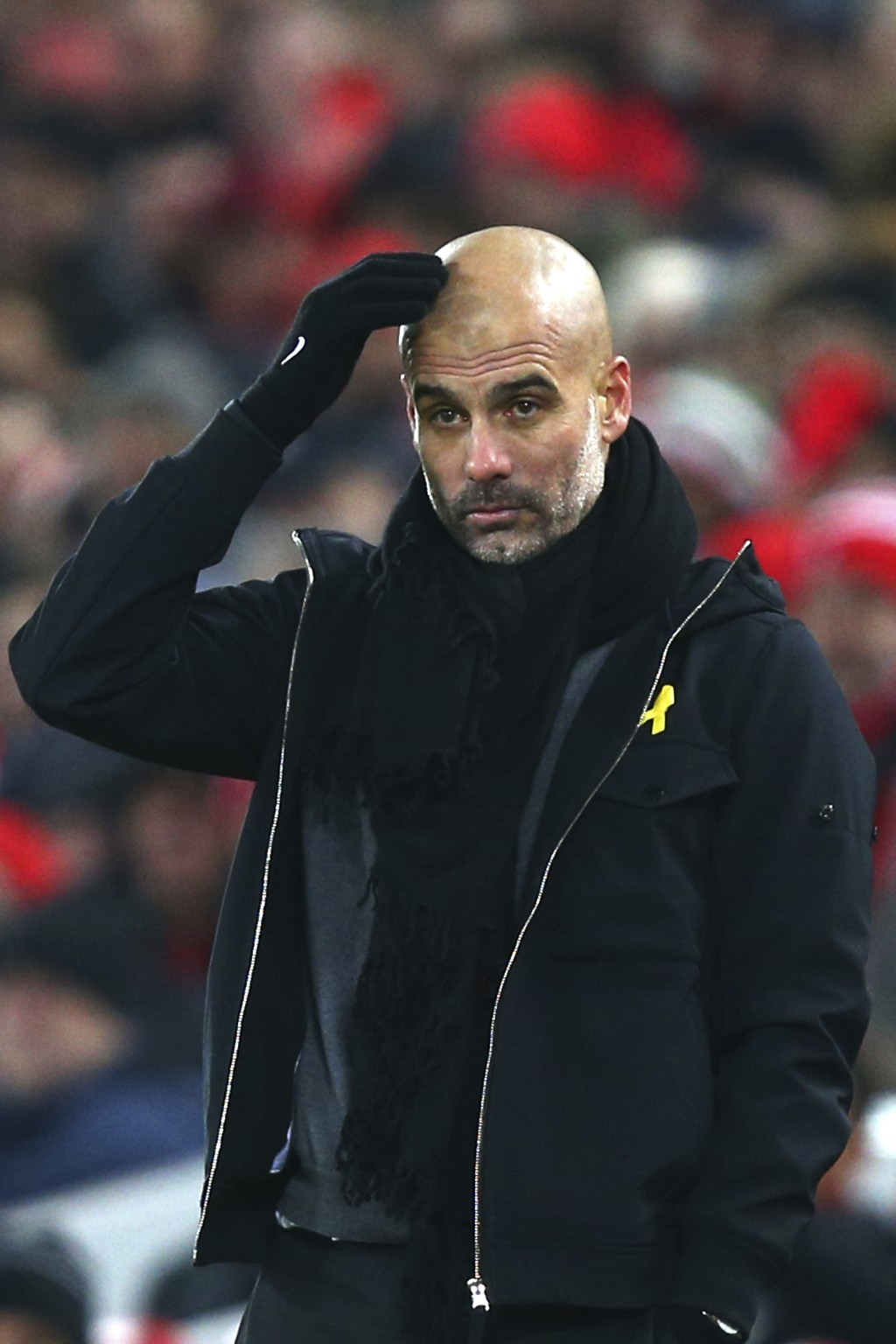 Manchester City's manager Pep Guardiola reacts during the English Premier League soccer match between Liverpool and Manchester City at Anfield Stadium
