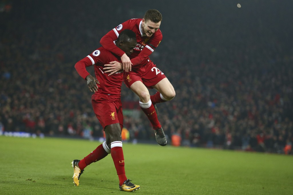 Liverpool's Sadio Mane, left, celebrates with Liverpool's Andrew Robertson after Mane scored his side's third goal during the English Premier League s