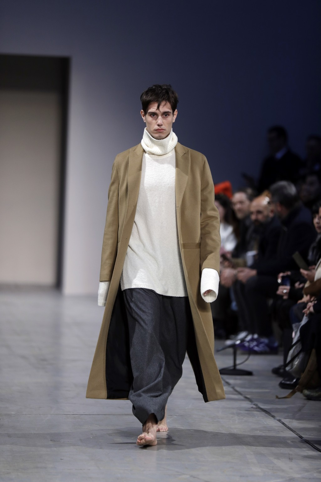 A model wears a creation of the Sartorial Monk as part of the men's Fall-Winter 2018-19 collection, presented in Milan, Italy, Sunday, Jan.14, 2018. (