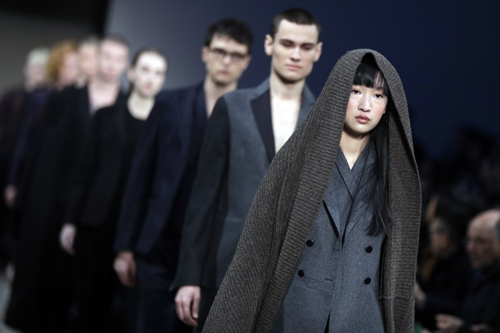 Models wear creations of the Sartorial Monk as part of the men's Fall-Winter 2018-19 collection, presented in Milan, Italy, Sunday, Jan.14, 2018. (AP