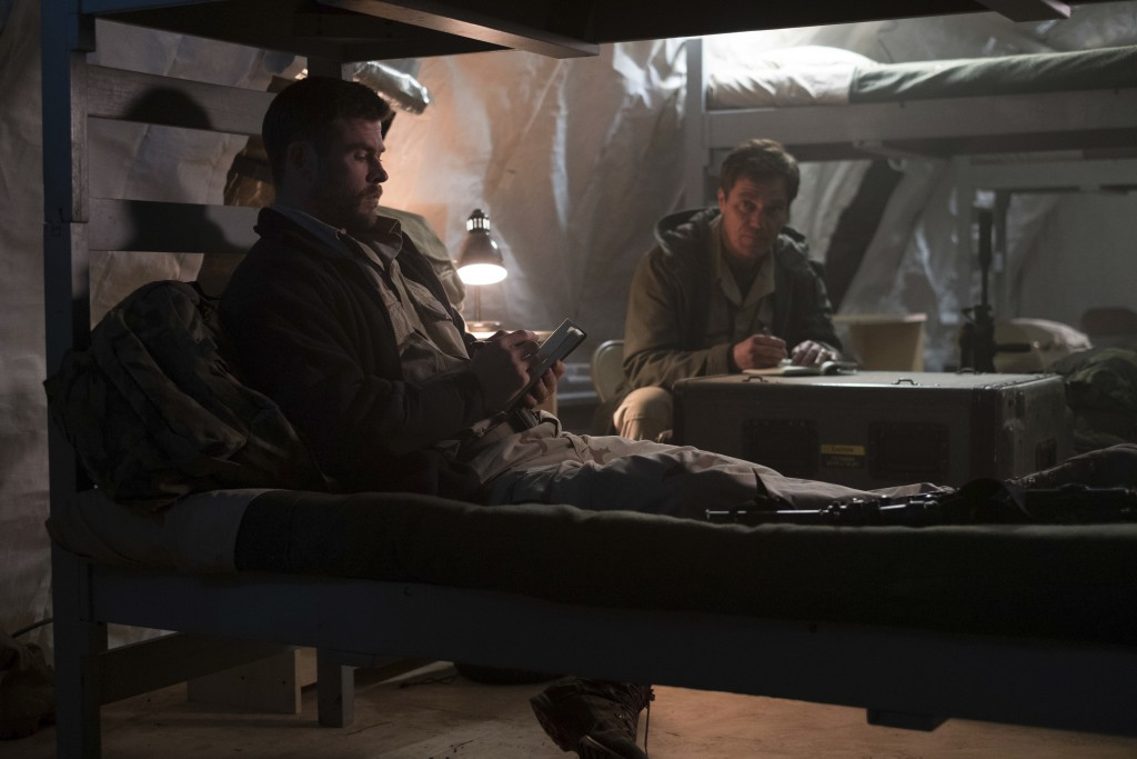 """This image released by Warner Bros. Entertainment shows Chris Hemsworth, left, and Michael Shannon in a scene from """"12 Strong."""" (David James/Warner Br..."""