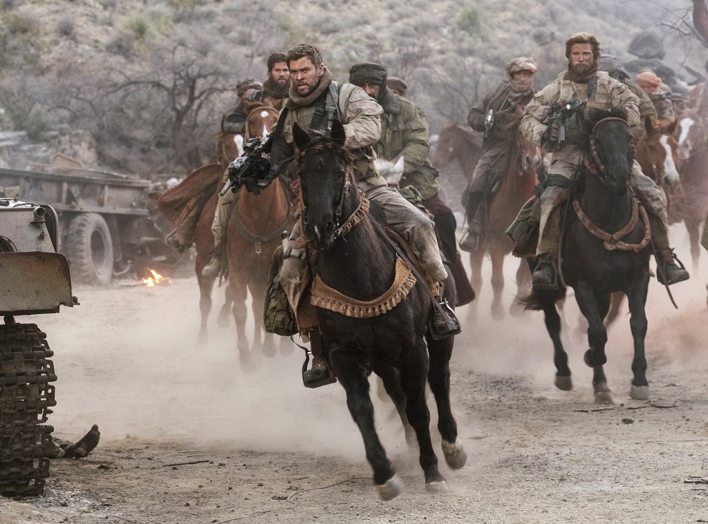 """This image released by Warner Bros. Entertainment shows Chris Hemsworth, center, in a scene from """"12 Strong."""" (David James/Warner Bros. Entertainment ..."""