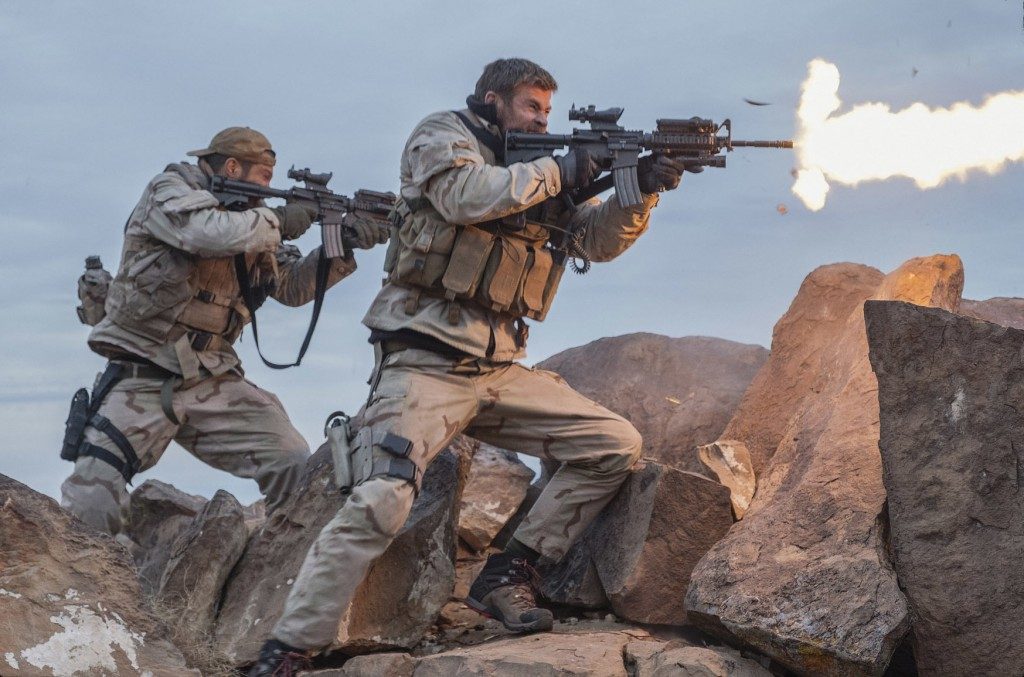 """This image released by Warner Bros. Entertainment shows Geoff Stults, left, and Chris Hemsworth in a scene from """"12 Strong."""" (David James/Warner Bros...."""