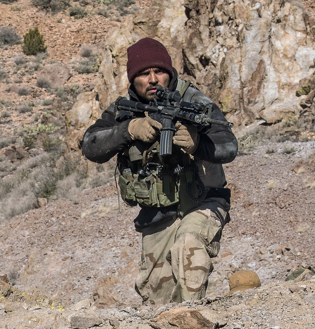 """This image released by Warner Bros. Entertainment shows Michael Pena in a scene from """"12 Strong."""" (David James/Warner Bros. Entertainment via AP)"""