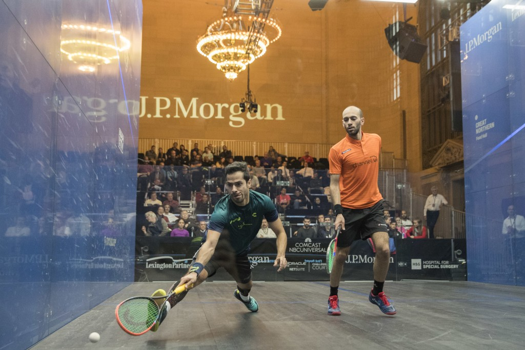 Cesar Salazar, left, of Mexico, returns a shot from Marwan El Shorbagy, of Egypt, during the JP Morgan Tournament of Champions professional squash com...