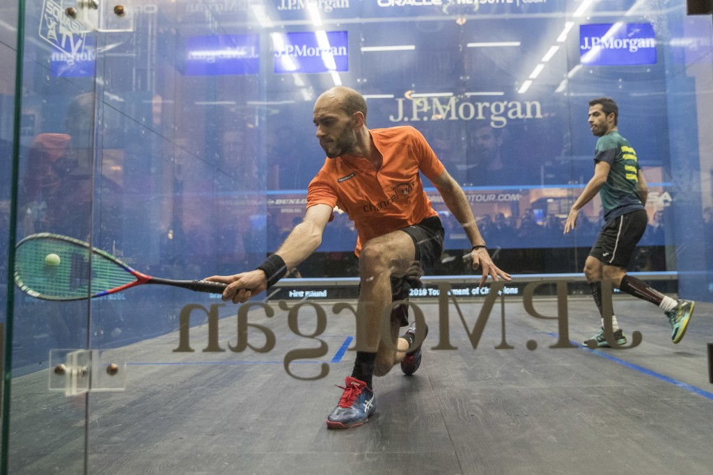 Marwan El Shorbagy, left, of Egypt, returns a shot from Cesar Salazar, of Mexico, right, during the JP Morgan Tournament of Champions professional squ...