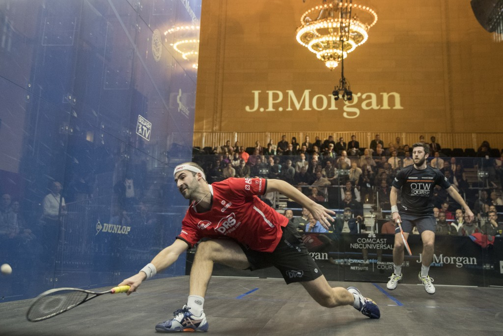 Simon Rosner, left, of Germany, returns a shot from Daryl Selby, of England, during the JP Morgan Tournament of Champions professional squash competit...