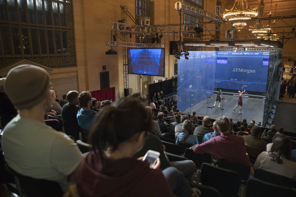 Simon Rosner, right, of Germany, competes against Daryl Selby, of England, inside a glass enclosure during the JP Morgan Tournament of Champions profe...