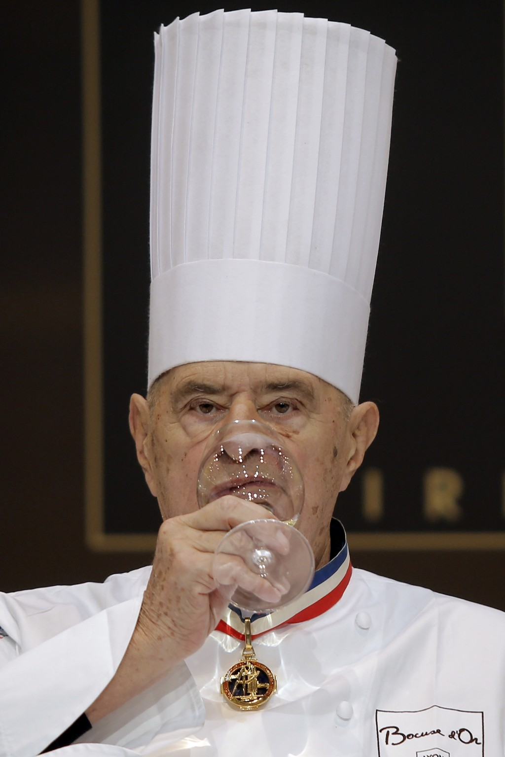 """FILE - In this Jan. 29 2013 file photo, French chef Paul Bocuse drinks as he tastes a dish during the """"Bocuse d'Or"""" (Golden Bocuse) trophy, at the 14t..."""