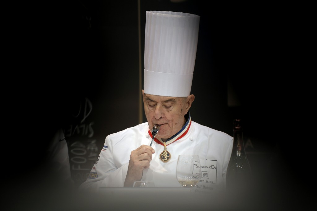 """FILE - In this Jan. 29 2013 file photo, French chef Paul Bocuse tastes a dish during the """"Bocuse d'Or"""" (Golden Bocuse) trophy, at the 14th World Cuisi..."""