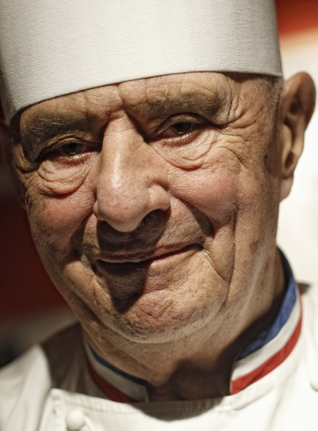 FILE - In this March 24, 2011 file French Chef Paul Bocuse smiles in his famed Michelin three-star restaurant L'Auberge du Pont de Collonges in Collon...
