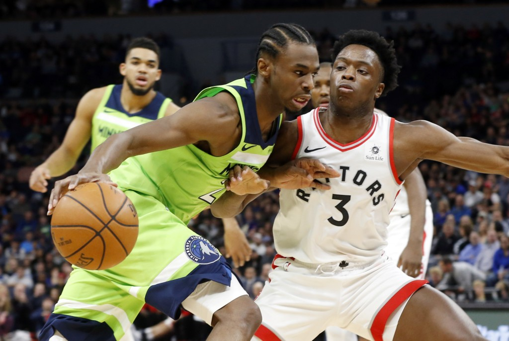 Minnesota Timberwolves' Andrew Wiggins, left, drives around Toronto Raptors' OG Anunoby, of England, in the first half of an NBA basketball game Satur...
