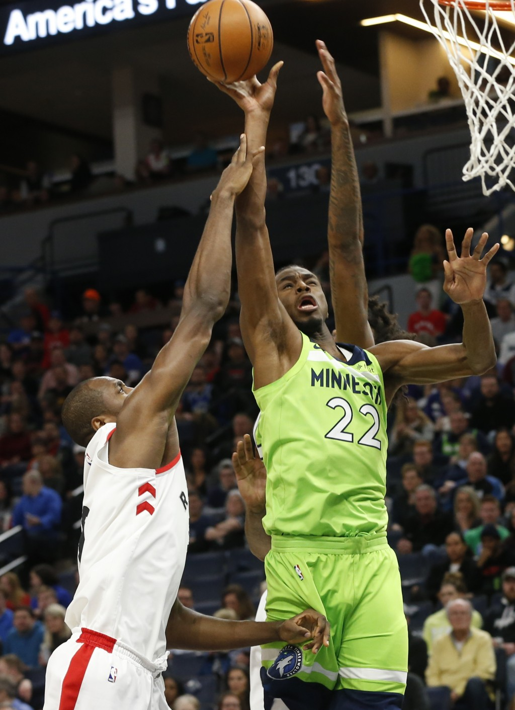 Minnesota Timberwolves' Andrew Wiggins, right, shoots as Toronto Raptors' Serge Ibaka defends in the first half of an NBA basketball game Saturday, Ja...