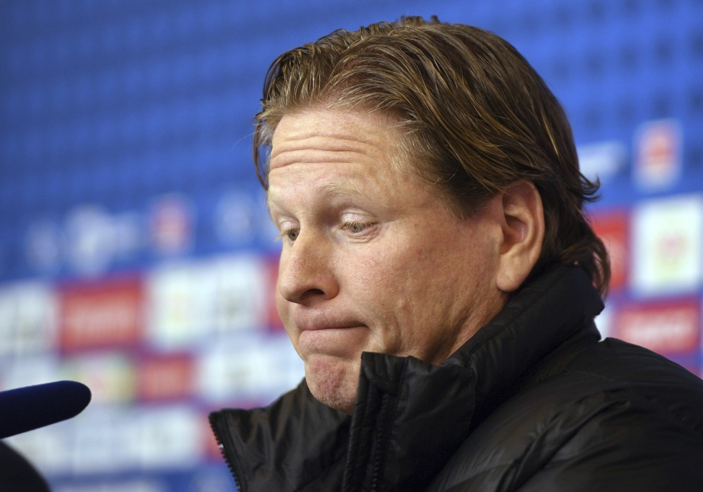 In this photo taken Saturday, Jan. 20, 2018 Hamburg's coach Markus Gisdol grimaces after the Bundesliga soccer match between Hamburger SV and 1. FC Co