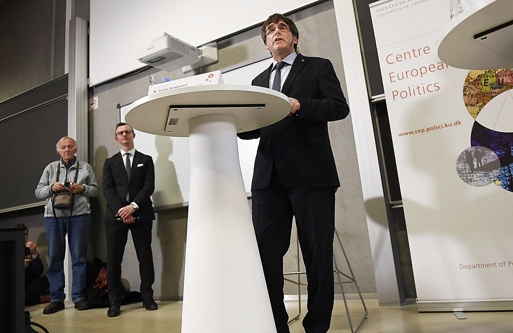 Carles Puigdemont vows to form new Catalan government, escapes European Union warrant